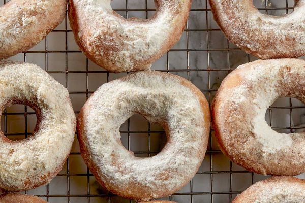 apple cider donuts coated in cinnamon, sugar, and freeze-dried apple powder
