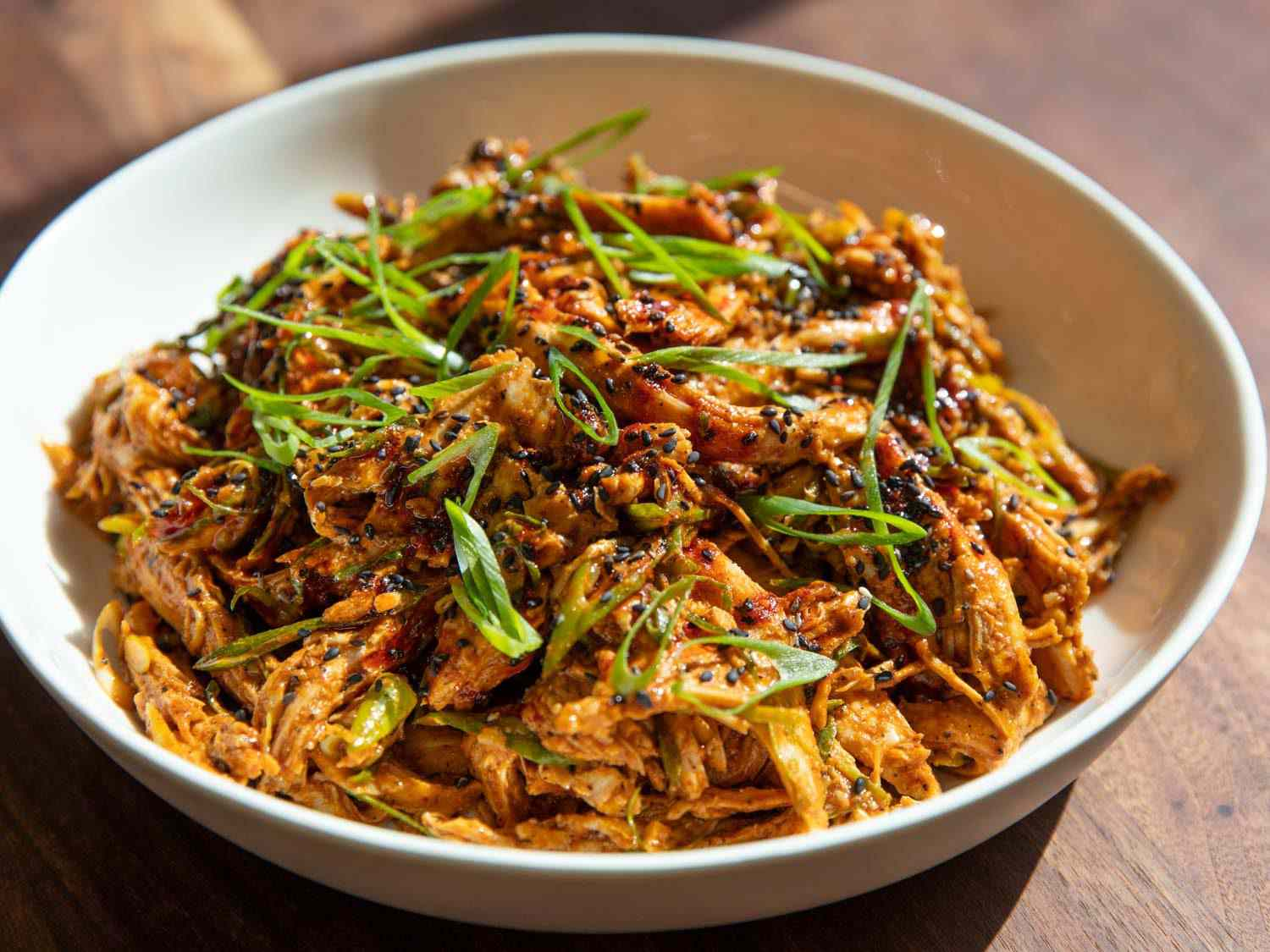 Closeup side view of a bowl of Sichuan-style turkey salad.