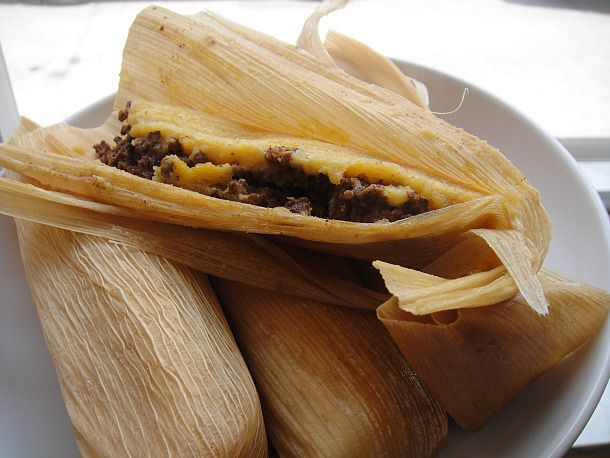 Four Mississippi Delta hot tamales on a plate.