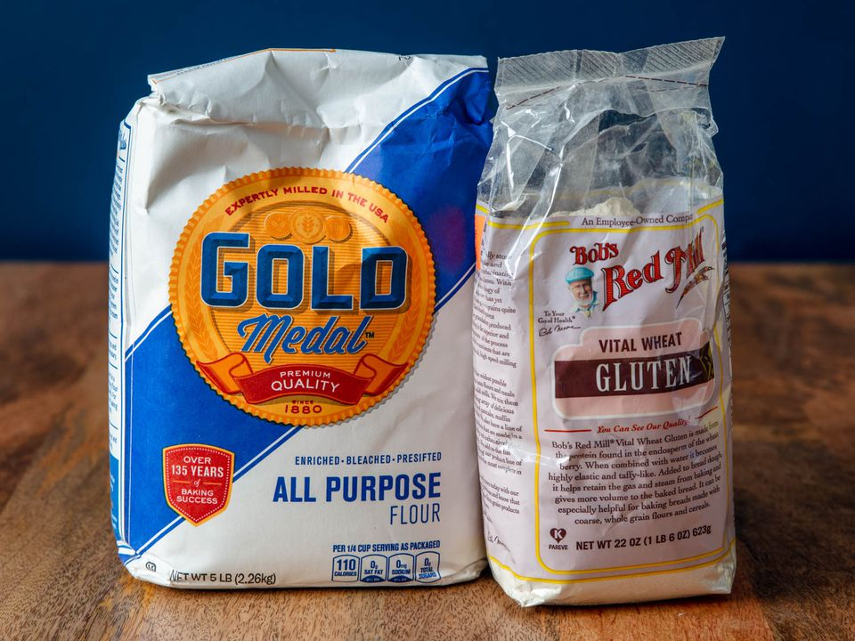 A bag of Gold Medal all-purpose flour next to a bag of Bob's Red mill vital wheat gluten