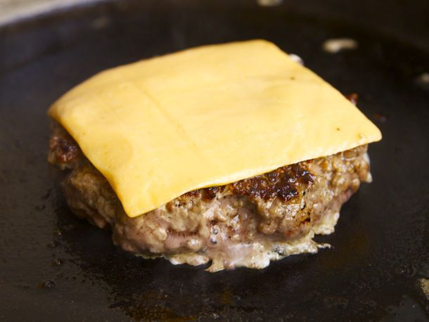 cheese slice on egg and burger patty