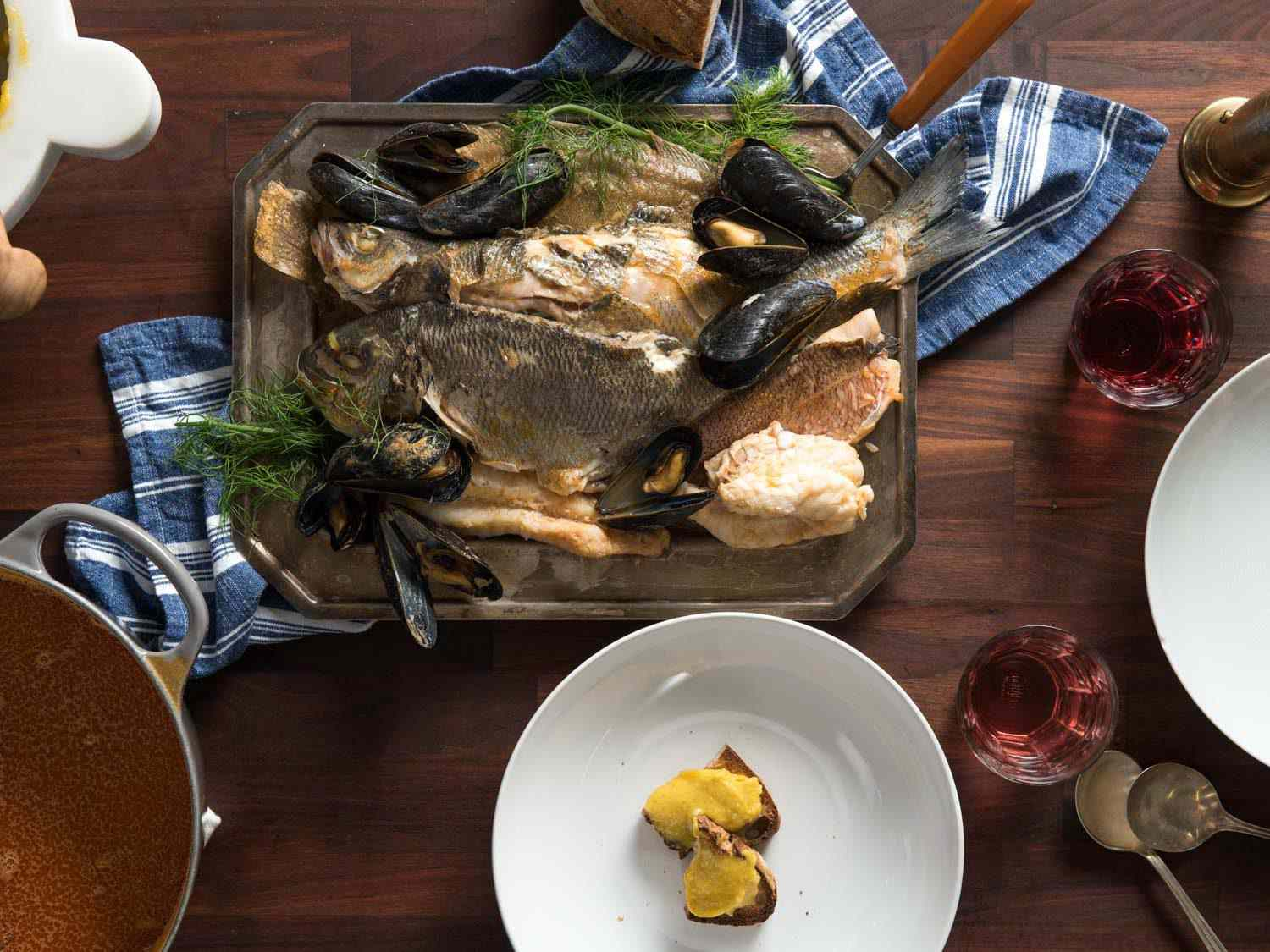 A table full of a bouillabaisse feast