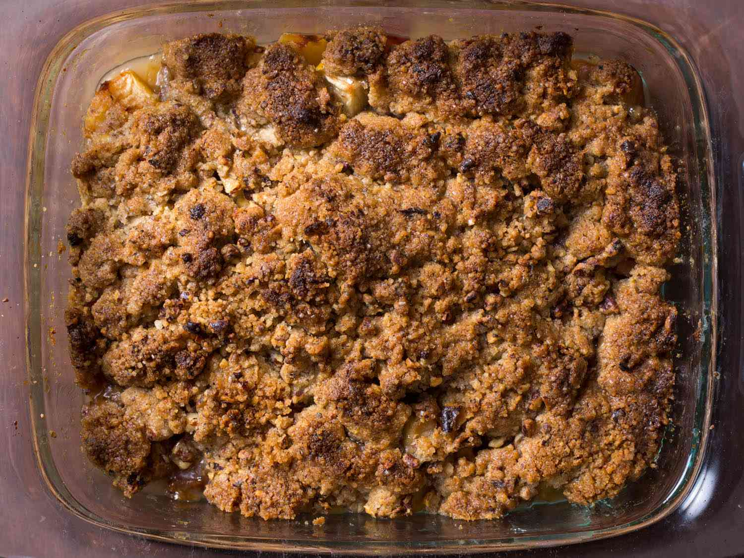 Overhead shot of a baked apple crisp, with a well-browned crumb topping