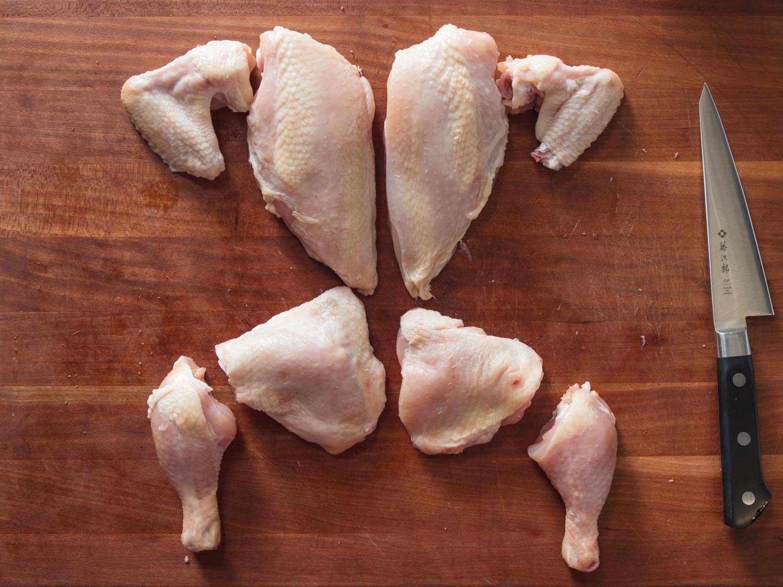Chicken broken down into 8 pieces.