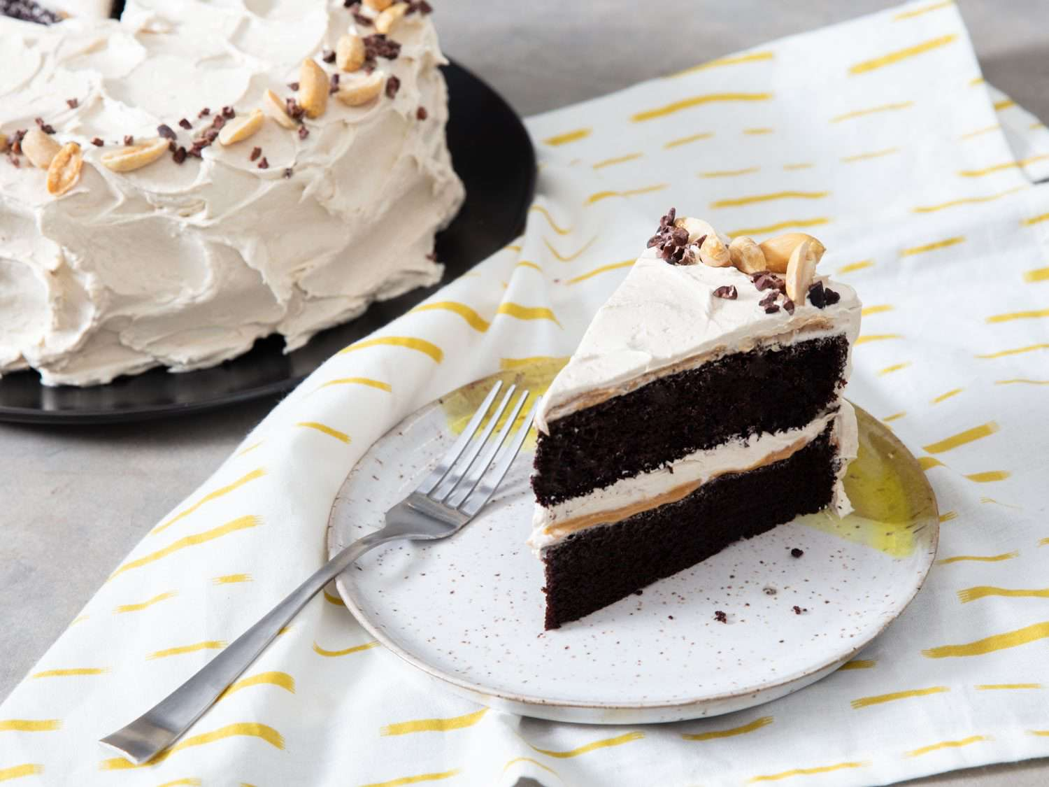 devil's food cake with banana frosting, peanuts, and cocoa nibs