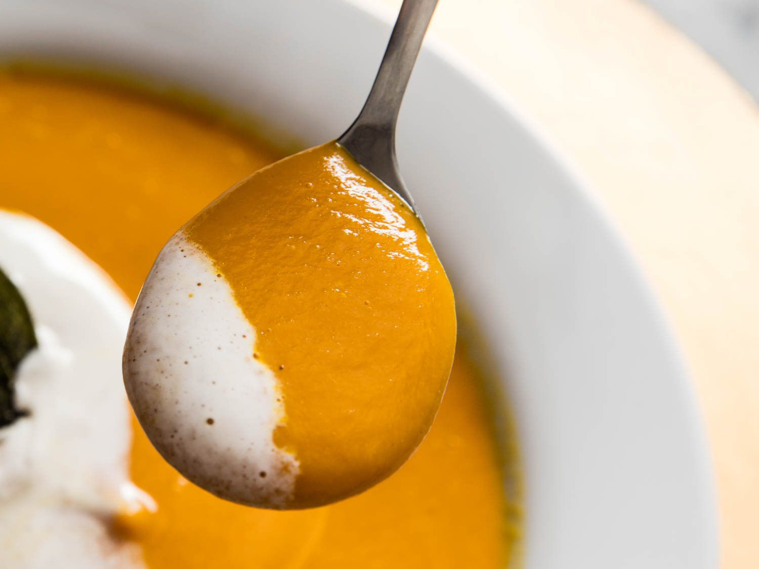 Close up photo of spoonful of butternut squash.