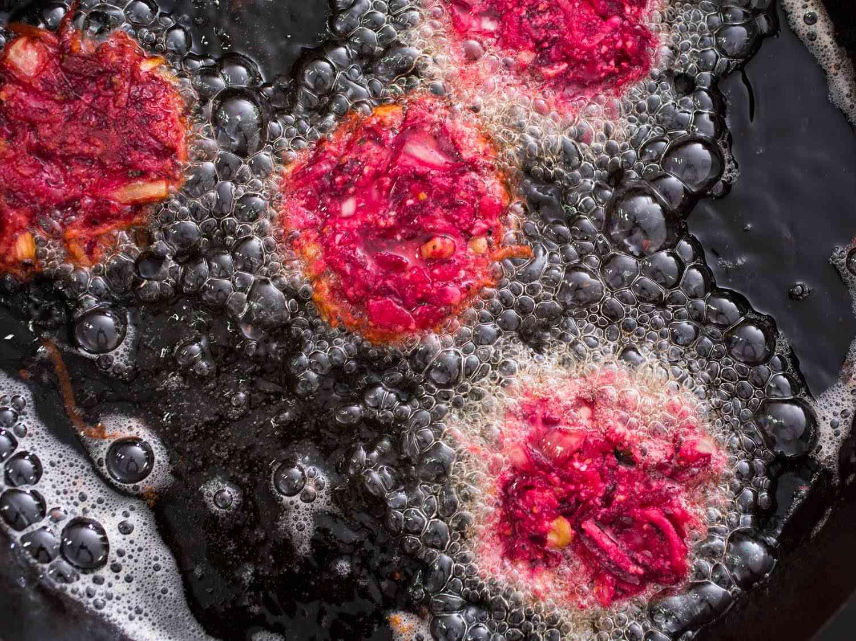 Beet latkes frying in oil
