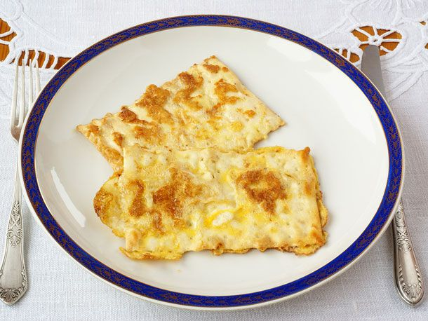Moonstrips (Onion-Poppy) Matzo Brei on a blue and white plate.