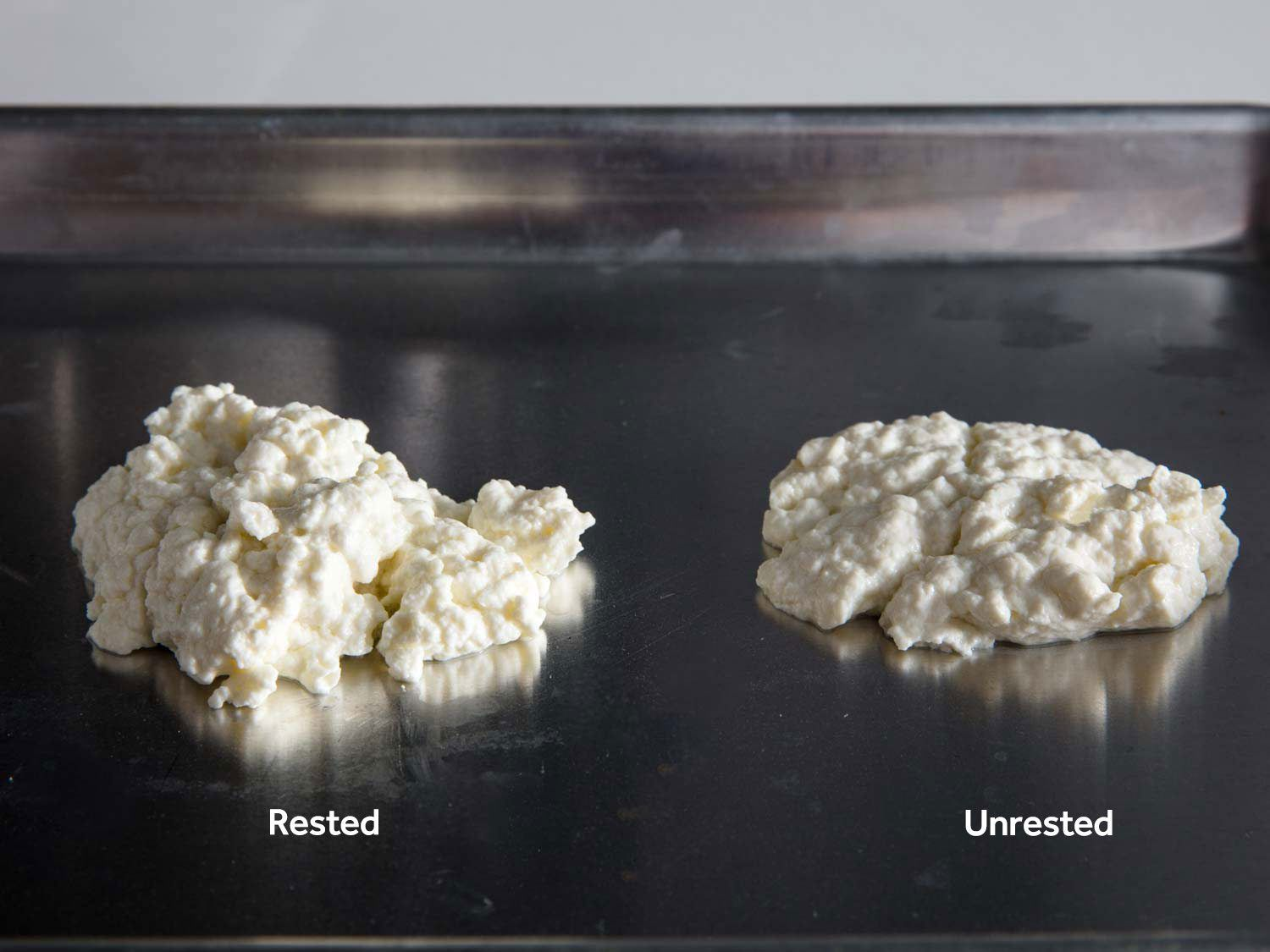 Lighter and fluffier curds on the left (produced by resting before skimming) and denser, drier curds on the right (with no rest before skimming)