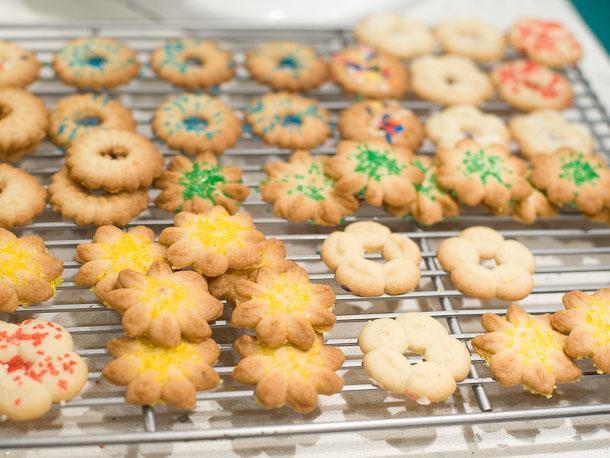 Spritz cookies cooling on wire rack
