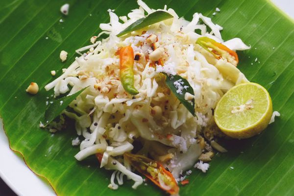 Quick Indian Cabbage Salad on a banana leaf with half a lime.