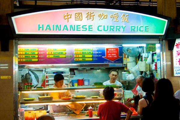 Hawker stand selling Hainanese curry rice in Singapore.