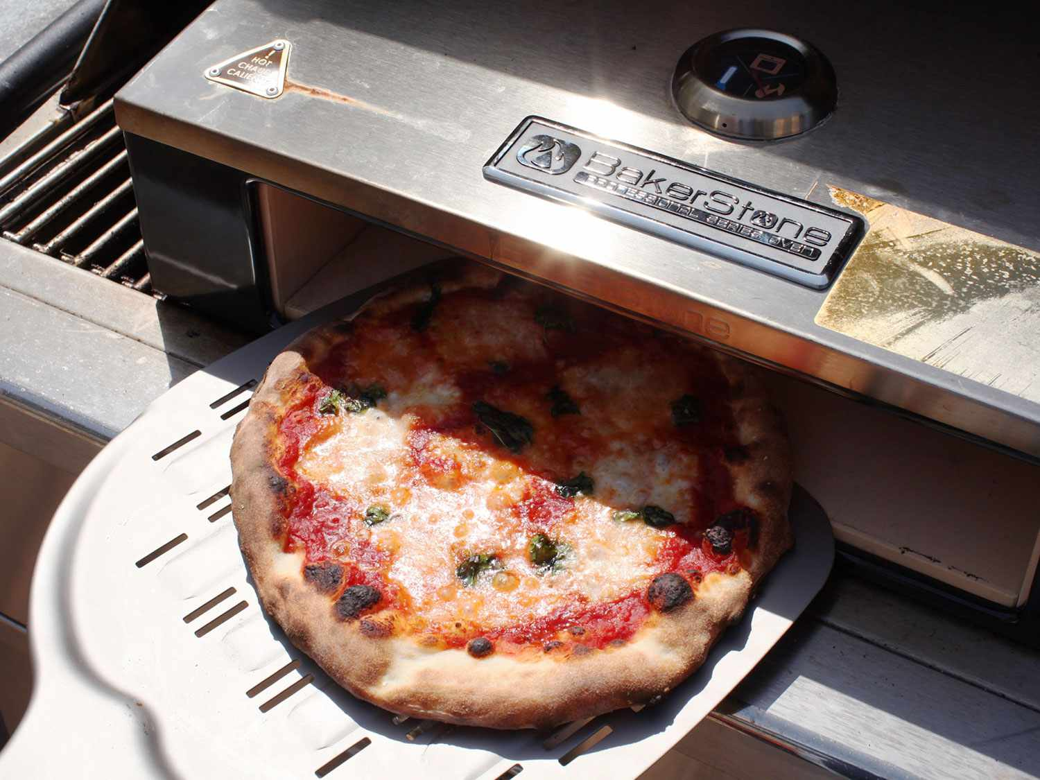 Testing cheese pizza in an BakerStone Box pizza oven