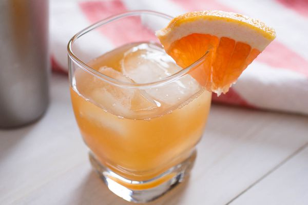 Blushing betty cocktail with grapefruit garnish