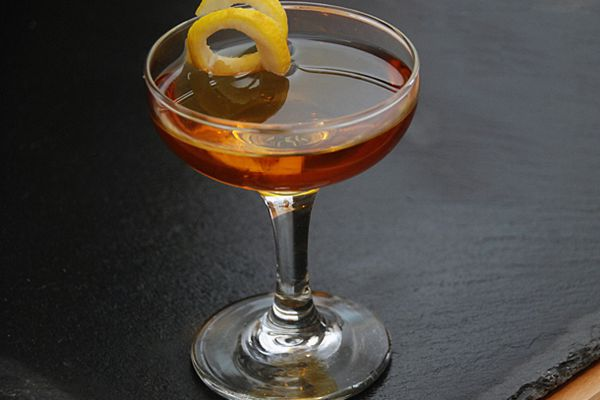 Norwegian Wood cocktail with lemon twist