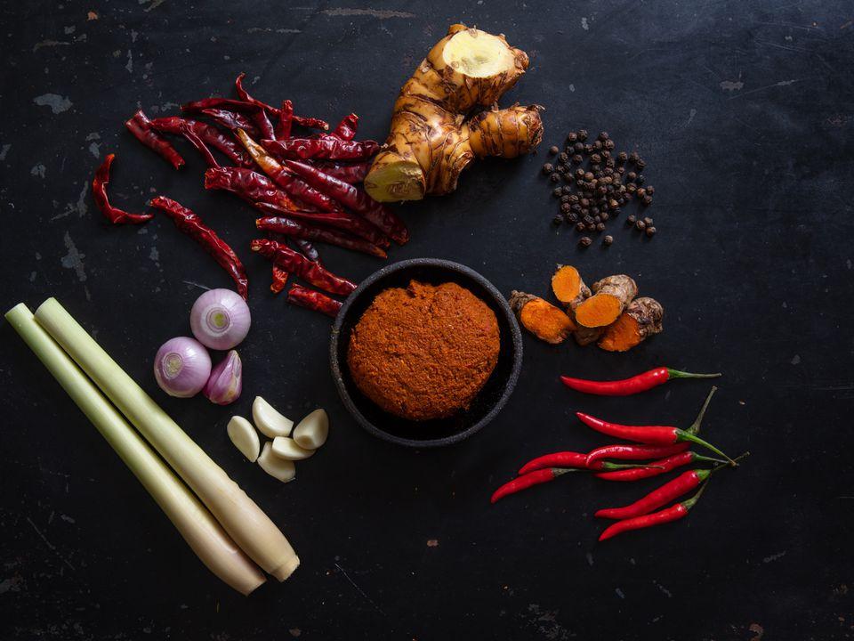 Prik Gaeng Pak Dtai (Southern Thai Curry Paste) with ingredients scattered around