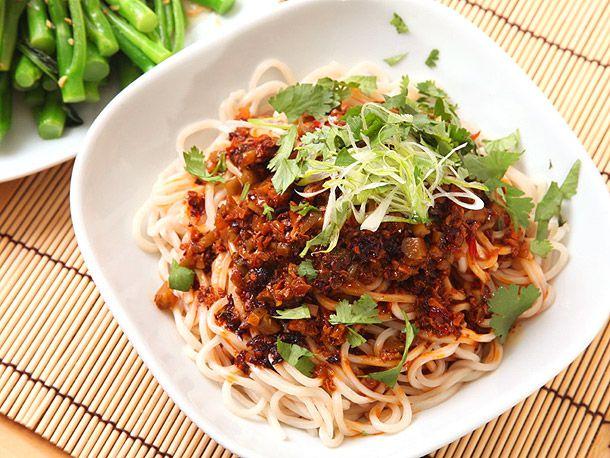 A dish of vegan dan dan noodles (noodles with chili oil, fried mushrooms, and Chinkiang vinegar)