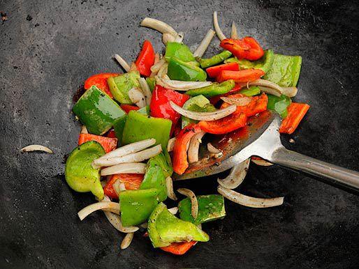 Vegetables being stir-fried in a wok.