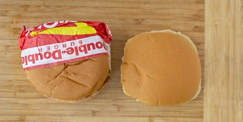 A side-by-side photo of an original In-N-Out hamburger bun and an Arnold bun.