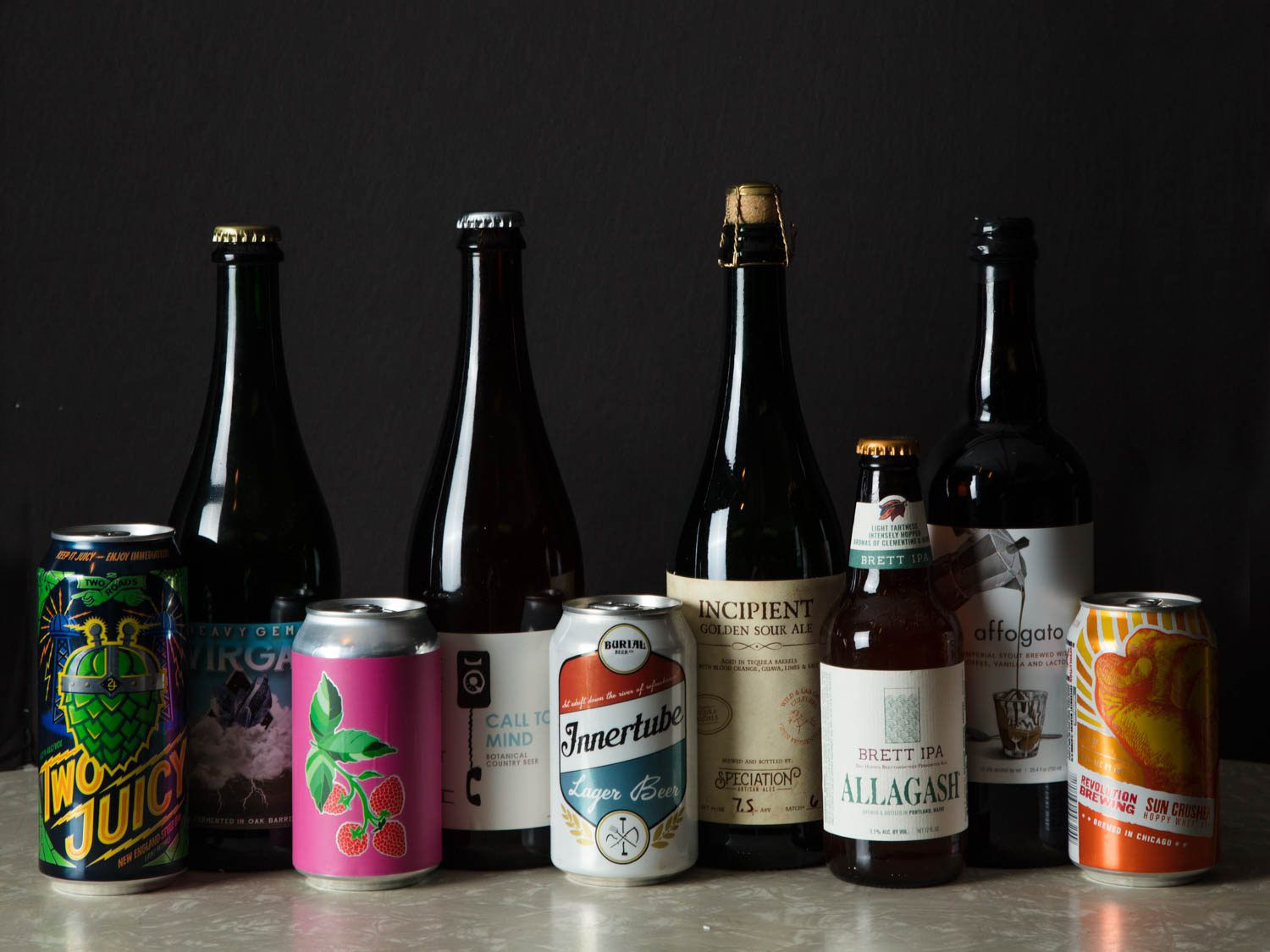 An assortment of beers in bottles and cans.