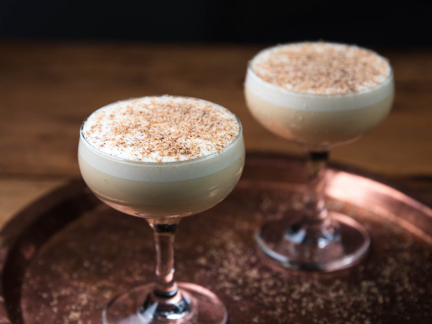 two glasses of frothy eggnog