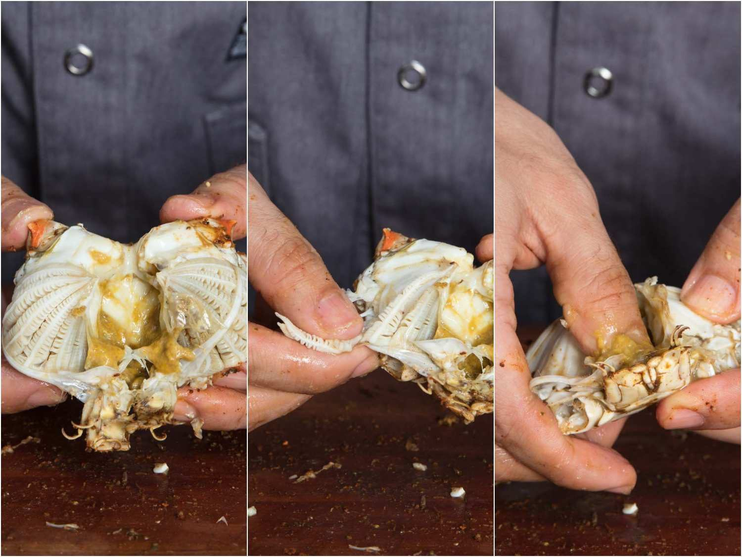 Opening up the bottom shell of a crab and removing the gills