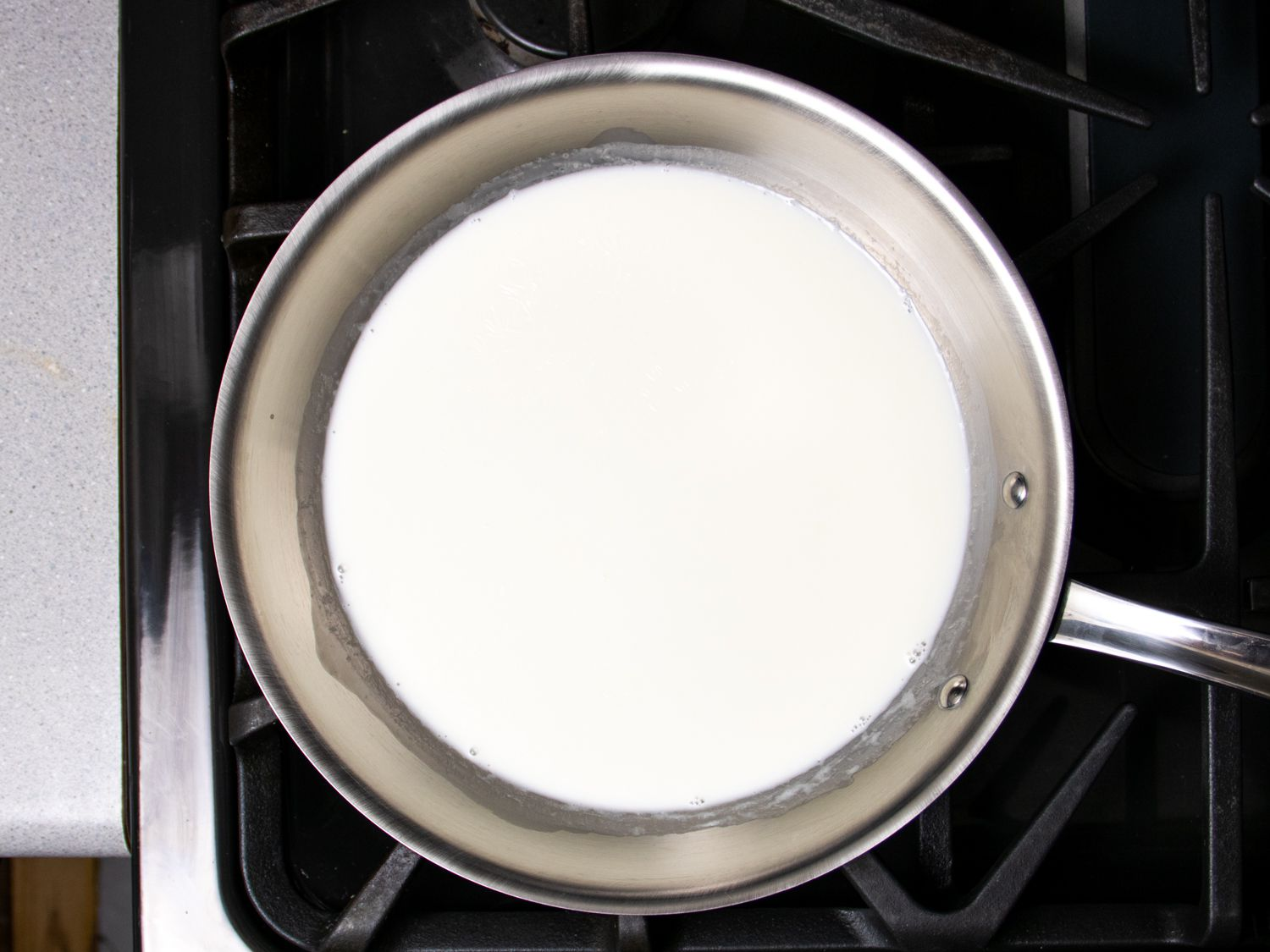 milk and cream cooking in a skillet