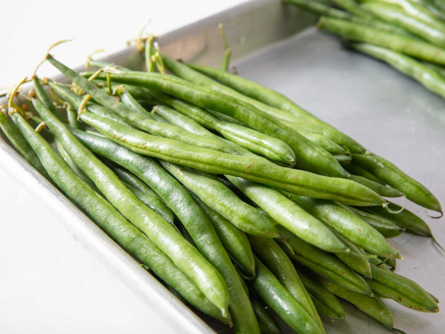 Closeup of whole raw green beans.