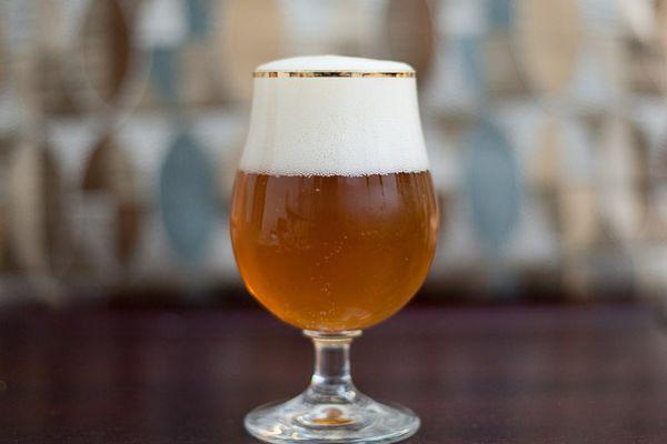 A glass of Belgian Tripel beer.