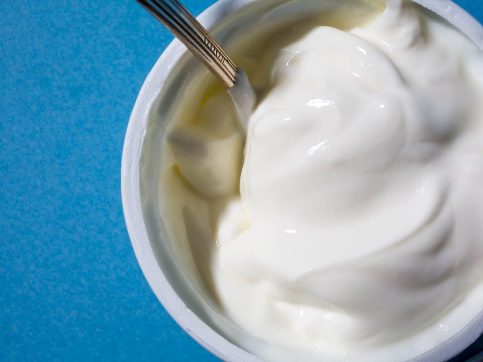 A container of plain yogurt.