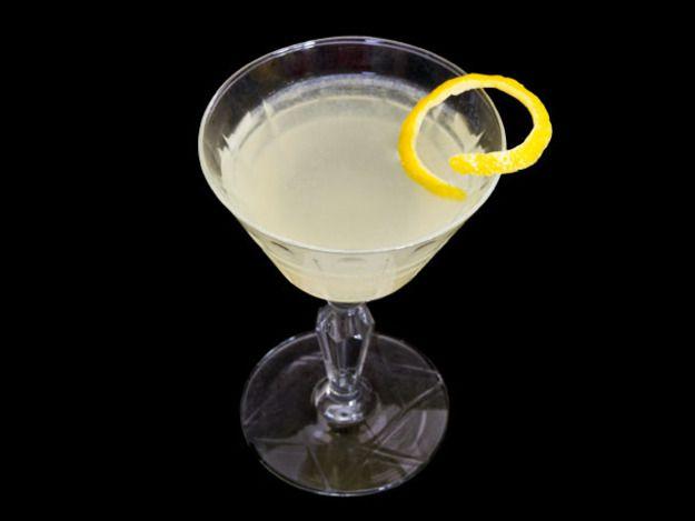 A Polaris cocktail with a twist of lemon peel on the rim.