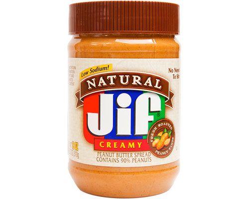 A jar of Jif Natural creamy peanut butter spread.