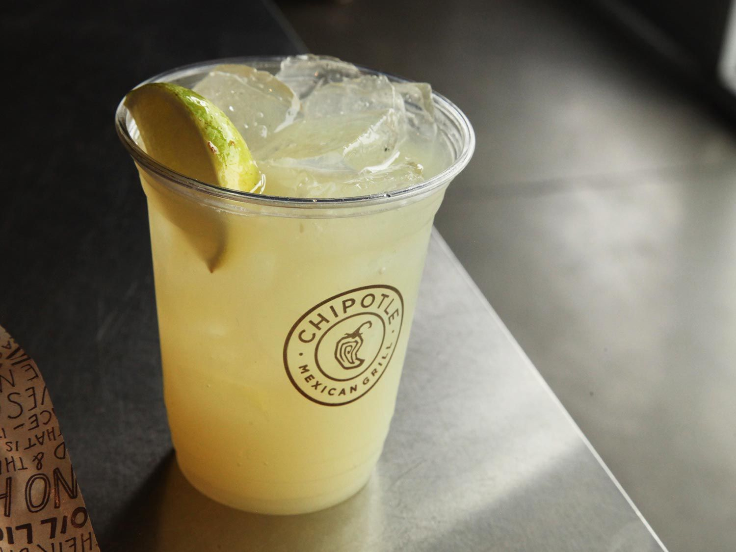 A margarita from Chipotle with a lime wedge in the cup