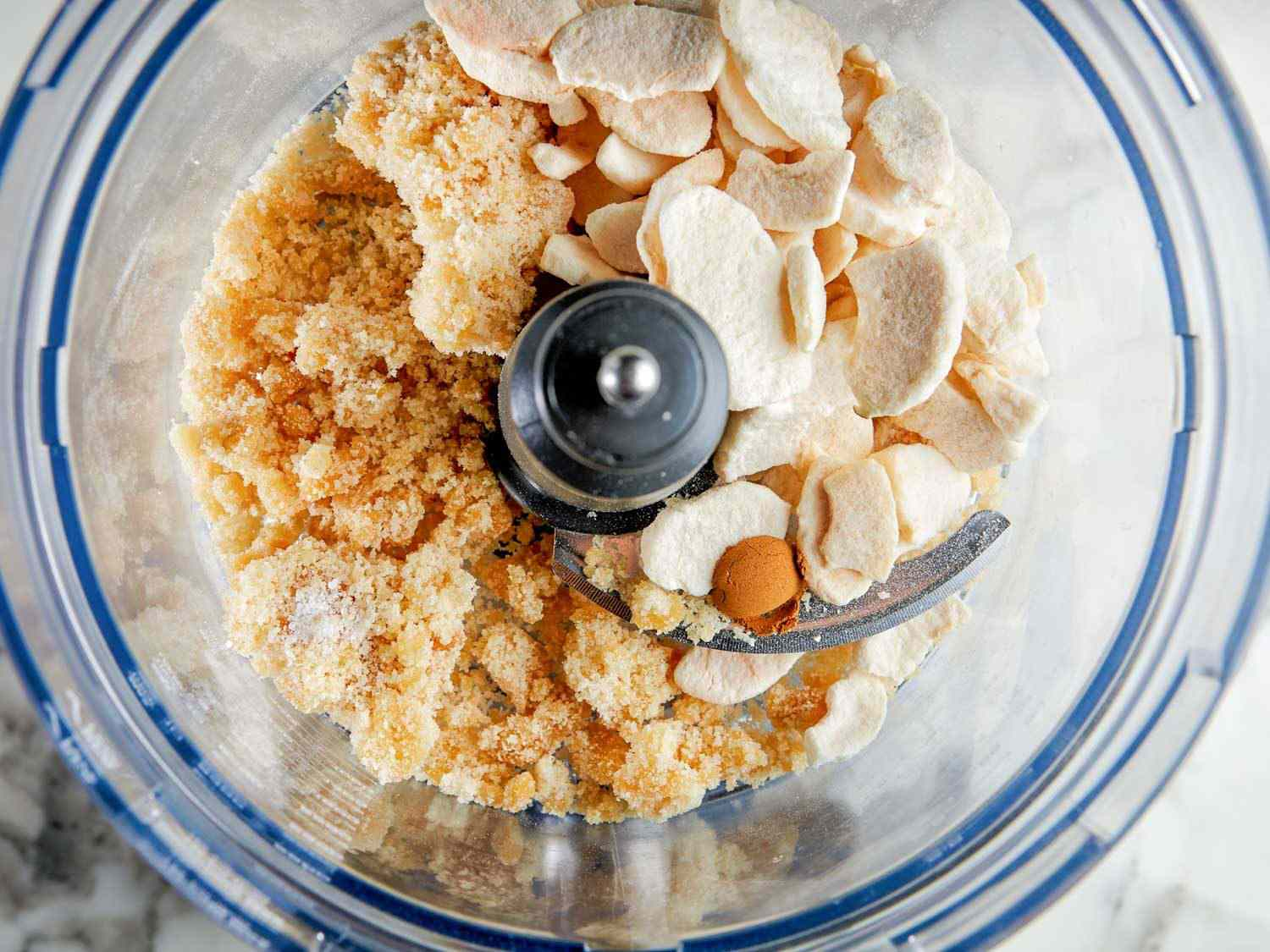 toasted sugar, freeze-dried apples, and spices in a food processor