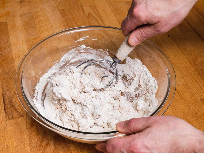a Danish dough whisk whisking flour