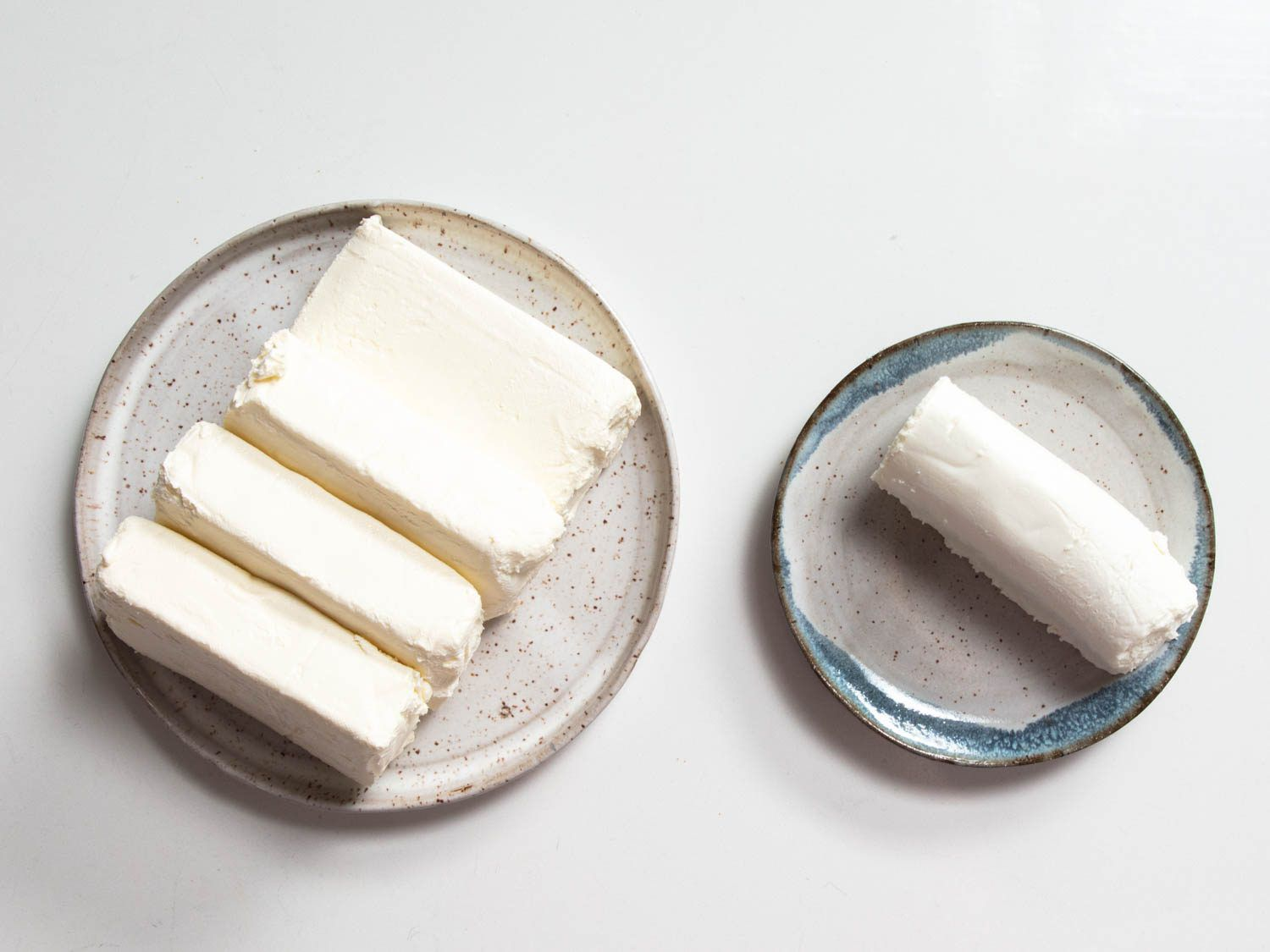 plates of cream cheese and fresh goat cheese