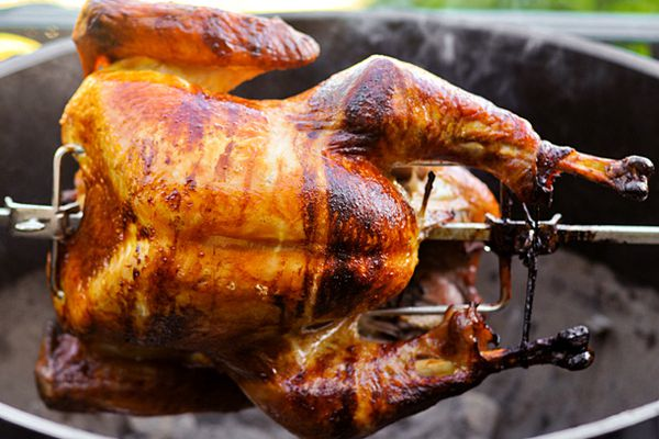 A turkey being cooked on a rotisserie.