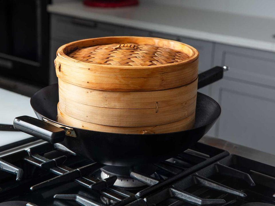 Bamboo steamer set in a wok