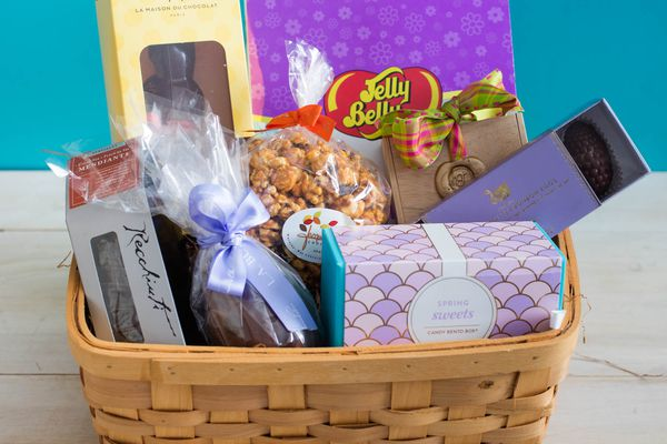 A basket of different candies and treats for Easter.