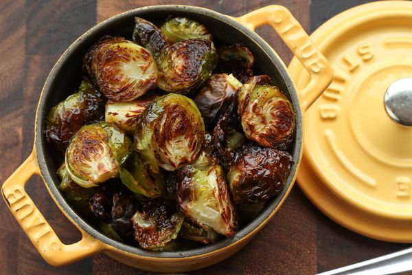 Caramelized roasted brussels sprouts presented in Dutch oven