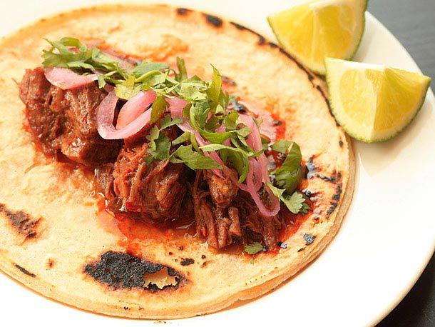 juicy barbacoa taco topped with cilantro
