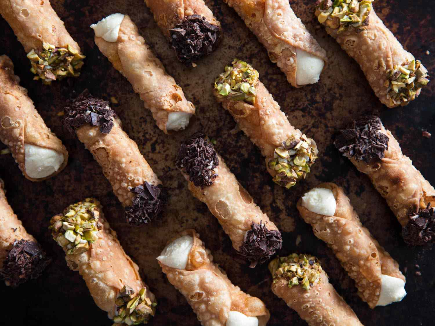 Homemade cannolis with pistachio and dark chocolate