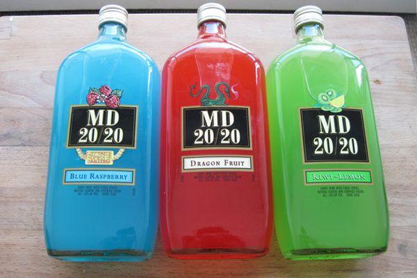 Three bottles of MD 20/20 next to each other: blue raspberry, dragon fruit, and kiwi-lemon.