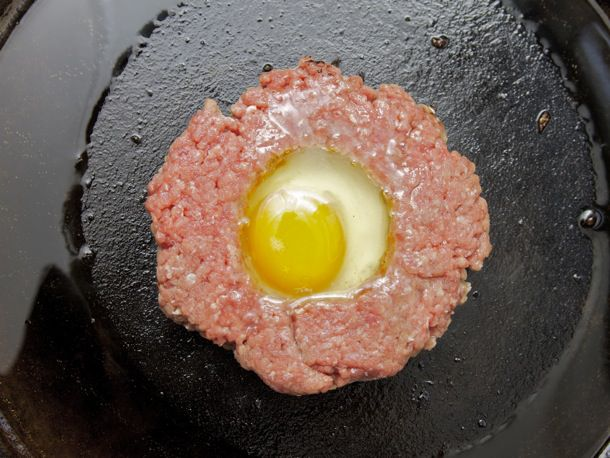 Burger with fried egg in the middle