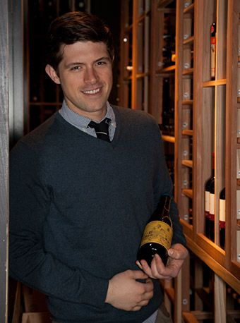 sommelier in front of a wine cellar