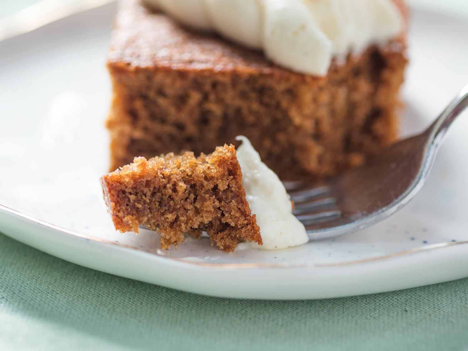 forkful of gingerbread cake and cream cheese frosting