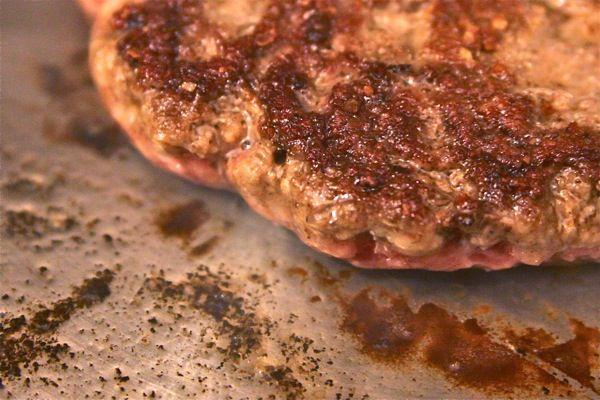 cooking burgers in pan