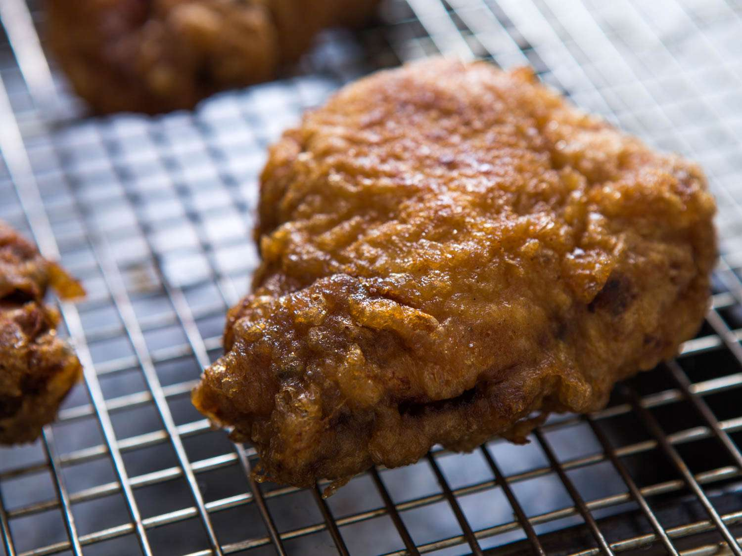 Tuscan-Jewish lemon fried chicken resting on a wire rack