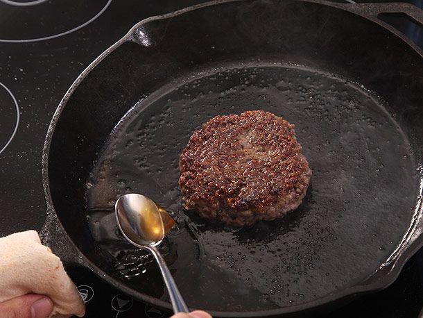 basting burger on cast iron skillet