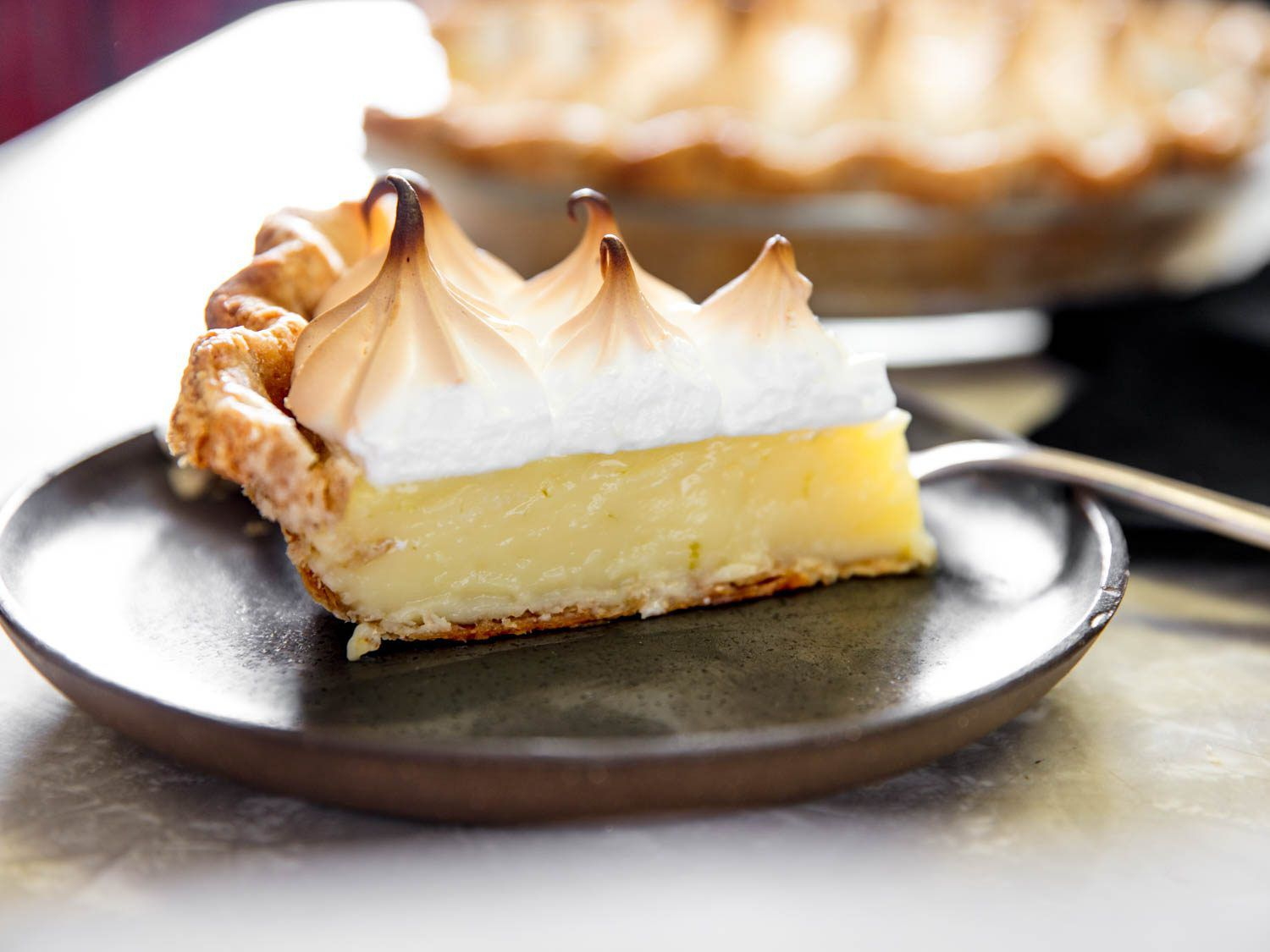 Slice of lime pie with meringue on a plate
